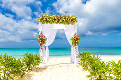 Wedding arch and set up on beach, tropical outdoor wedding Royalty Free Stock Images