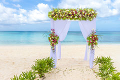 Wedding arch and set up on beach, tropical outdoor wedding. Cabana on beach Stock Images