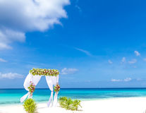 Wedding arch and set up on beach, tropical outdoor wedding. Cabana on beach Royalty Free Stock Photos