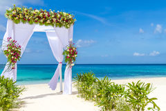Wedding arch and set up on beach, tropical outdoor wedding. Cabana on beach Royalty Free Stock Photo