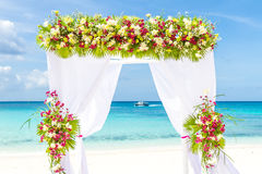 Wedding arch and set up on beach, tropical outdoor wedding Stock Photo