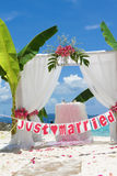 Wedding arch and set up with flowers on beach Royalty Free Stock Photography