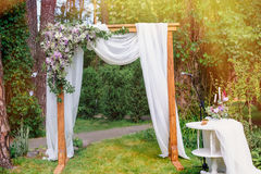 Wedding arch in the style of rustic pine summer park Royalty Free Stock Photo