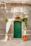 Wedding Arch of sunflowers. The ceremony at the St. Nikola Churc Royalty Free Stock Photography