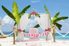 Wedding arch - tent - decorated with flowers. On beach, tropical wedding ceremony set up Royalty Free Stock Photos