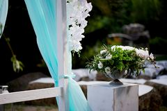 Wedding Arch of turquoise color on background lake. Wedding Arch of turquoise color on the background lake Royalty Free Stock Photos