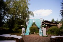 Wedding Arch of turquoise color on background lake royalty free stock image