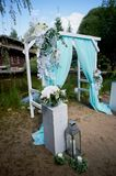 Wedding Arch of turquoise color on background lake. Wedding Arch of turquoise color on the background lake Stock Photography