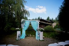 Wedding Arch of turquoise color on background lake. Wedding Arch of turquoise color on the background lake Stock Photos