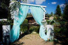 Wedding Arch of turquoise color on background lake. Wedding Arch of turquoise color on the background lake Stock Images
