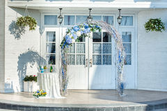 Wedding arch of vines with flowers. Luxury wedding arch of vines with blue and white flowers with table Stock Images