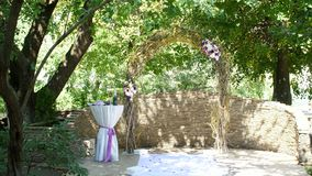 Wedding arch for the wedding ceremony, wedding decoration, decoration of the wedding ceremony, wedding decorations made stock footage