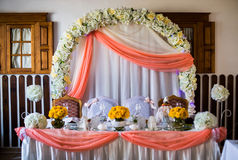Wedding arch of white flowers decorated wedding table Royalty Free Stock Photo