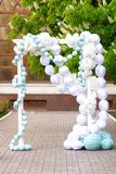 Wedding arch of white flowers royalty free stock photo