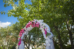 Wedding arch with white and pink flowers Royalty Free Stock Image