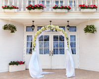Wedding archway with flowers. Arranged for a wedding ceremony Royalty Free Stock Photography