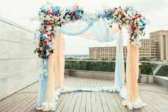 Wedding archway with flowers arranged in city for a wedding cere Stock Photo