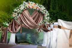 Wedding archway with flowers arranged in park Stock Image