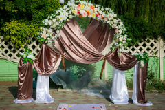 Wedding archway with flowers arranged in park Royalty Free Stock Photography