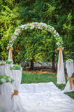 Wedding archway with flowers arranged in park  for a wedding ceremony Stock Photography