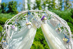 Wedding archway with flowers arranged for a wedding ceremony Stock Photography