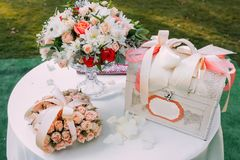 Wedding area decorated with gifts and flowers composition on the table.Copy space. Wedding area decorated with gifts and flowers composition on the table. Copy royalty free stock photography