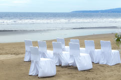 Wedding Arrangement. An arrangement of chairs and glasses, for a wedding on a beach Stock Image