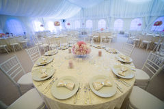 Wedding arrangement. Wedding tables in a tent prepared for a wedding stock photography