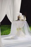 Wedding arrangement in garden. With champagne on a decorated table Royalty Free Stock Photo
