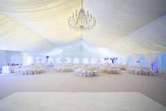 Wedding arrangement. Wedding tables in a tent prepared for a wedding royalty free stock image