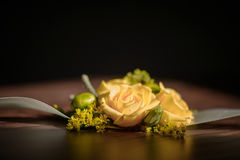 Wedding floral centerpiece with yellow rose at its core against a dark background. Wedding arrangements, floral setting, accessories, concepts, details, ideas Royalty Free Stock Image