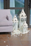 Wedding art decor. close up. Wedding art decor. candles in the lamp in the form of the castle under glass. sofa door close up Stock Image