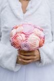 Wedding artificial bouquet in the bride hands. Beautiful wedding artificial bouquet in the bride hands Stock Image