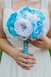 Wedding artificial bouquet in the bride hands Royalty Free Stock Images