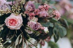 Wedding asymmetrical stylish bouquet with purple roses. Pink roses and white flowers stock photos
