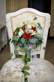 Wedding autumn bouquet on a chair Stock Image