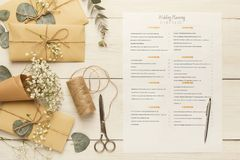 Bridal background with planner checklist. Wedding background with checklist. Paper planner and craft envelopes on white wooden table with lots of tender bridal Royalty Free Stock Photography
