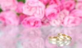 Wedding background with flowers and rings Royalty Free Stock Images