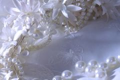 Wedding background with lace, pearls and ribbons. royalty free stock images
