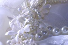 Wedding background with lace, pearls and ribbons. royalty free stock image