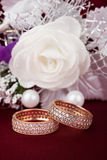 Wedding background with two rings and rose Stock Photo