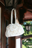 Wedding bag. Weddnig  bag hanging on a lamp Stock Photos