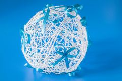 Wedding ball with bows on a blue background of threads Royalty Free Stock Photo