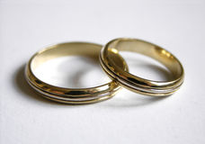 Wedding Bands. Two wedding rings on a white background Royalty Free Stock Photo