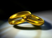 Wedding-bands. Computer-generated 3D illustration depicting two gold wedding bands linked together Royalty Free Stock Image