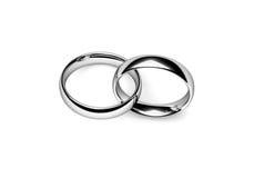 Wedding Bands. Set of interlocking platinum wedding rings over white Royalty Free Stock Images