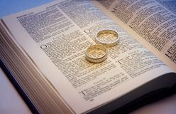 Wedding Bands on a Bible. Two wedding rings on a bible Stock Photo