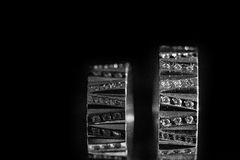 Wedding bands on the black background. A Royalty Free Stock Photography