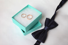 Wedding bands and bowtie Stock Images