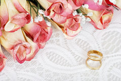 Wedding bands with bunch of roses Stock Photo